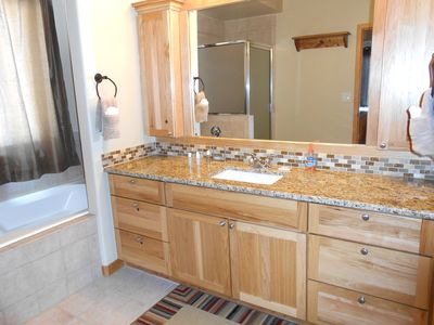 King Master Bath has large soaker tub and walk-in shower