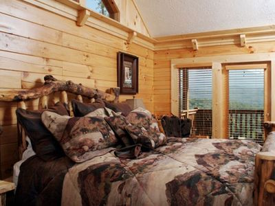 Main Level Bedroom with Massive Log King Bed, Deck Access and Views