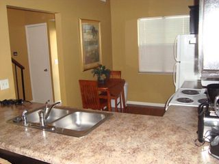 Orange Beach townhome photo - Dining for 2 With Room for 4 More at the Breakfast Bar!