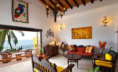 Living room has handcarved colonial furniture, Mexican decor and art throughout