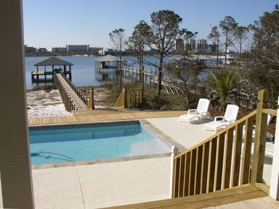 View from large deck and screen porch overlooking pool and Old River