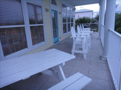 Large 37'x10' balcony with chairs, two picnic tables and BBQ grill