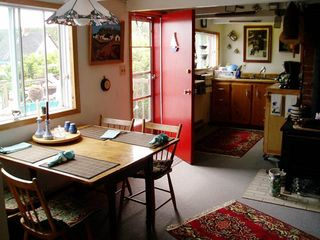 Ingonish cottage photo - A dining area off the kitchen also has an ocean view.
