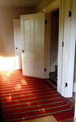 Rhinebeck house photo - Generous front hall with entry to living room, stair hall, and library