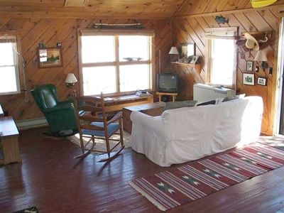 End cabin living room - lake is just outside the window.