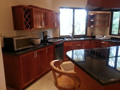 spacious kitchen with island seating 6 -8