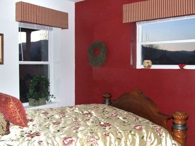 Queen bed on lower level with a beautiful view of the mountains from all windows
