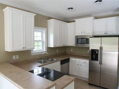 Modern kitchen with upgraded appliances.