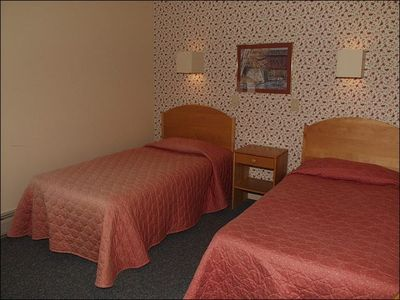 A Second Bedroom is Available on the First Floor Offering Two Comfortable Twin B
