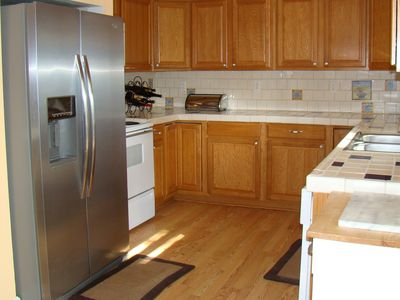 Remodeled Kitchen with New Stainless Steel Fridge