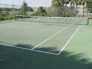 Sun Lake condo photo - Lighted tennis court for match play day or night.