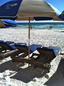 Two beach chairs and umbrella set up is included in our rate.