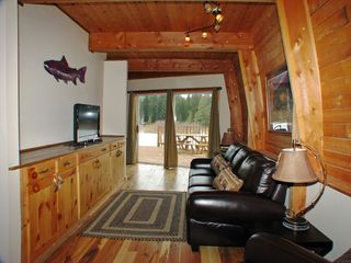 West Yellowstone house photo - Lounge with large screen Satellite TV, DVD, access to deck, BBQ. Wireless DSL.