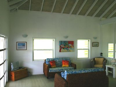 BeachComber Great Room, with comfy seating & TV/DVD player... opens to balcony!