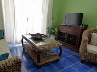 Curacao townhome photo - Open space living room and kitchen-newly painted, new furniture, 23 inch TV