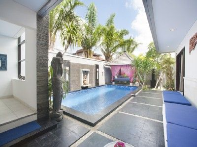 Spacious palm-lined outdoor area with private pool