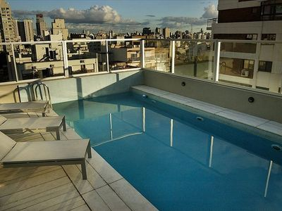 Rooftop pool on 11th floor with lounge area and panoramic views.