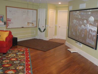 110 inch projection TV with surround sound plus two swings and kids whiteboard