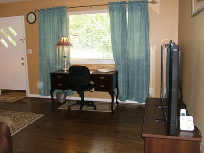 50' LCD HDTV and HDDVR. On Demand in living room. Work desk email and reports