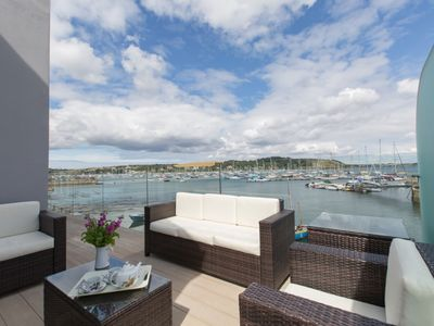 Nightingale House Furnished balcony with harbour views