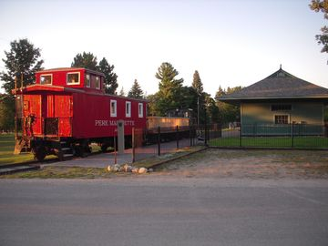By the deck is the play park and historic depot and train cars w/ Red Caboose