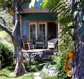 Bisbee cabin rental - The rocker filled porch is a perfect place to relax