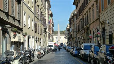 Via di Ripetta and piazza del Popolo,  a grocery and a renowned butcher nearby.