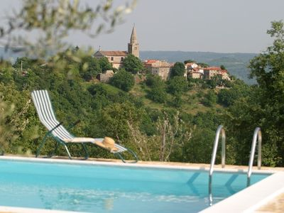 Beautiful villa with a pool in a quiet place, surrounded by greenery.
