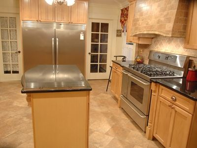 Features: 5 burner stove with 2 ovens, Fridge /Freezer combo, Wall Oven, etc.