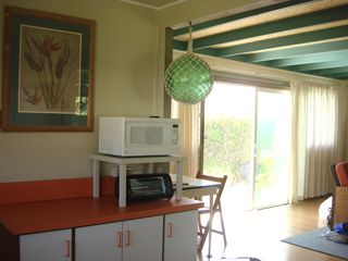 Kailua house photo - Kitchen flows to the living room and the small desk for your working vacation.