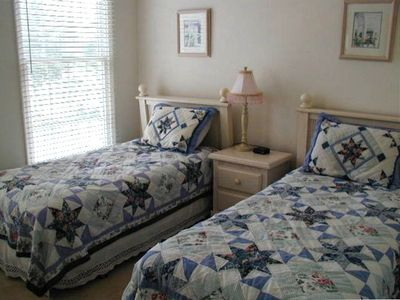 ...a bedroom with 2 twin beds and a full bath just outside it...