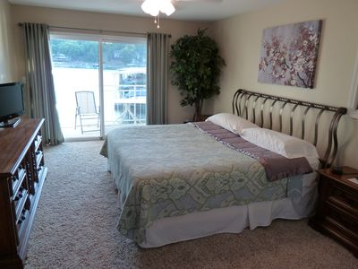 Large master bedroom, King Bed, ceiling fan, and private deck.