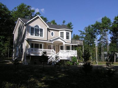 Front of Mayapple Cottage with sunny Front Porch and beautiful windows