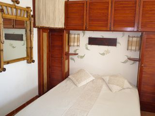 Marigot condo photo - A comfortable bed in a tropical atmosphere.