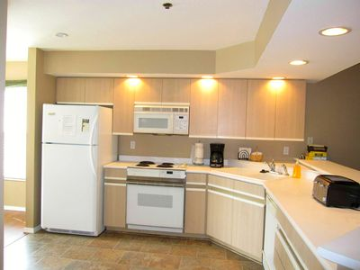 The condo has a fully stocked kitchen. Save money by eating 1 meal in each day