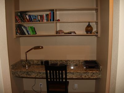Desk area with granite countertop