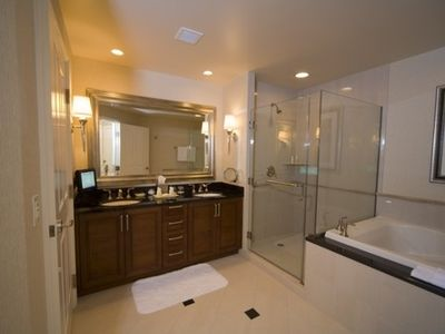 Bathroom with glass shower, jacuzzi tub, dual sink, granite top & flat panel TV!