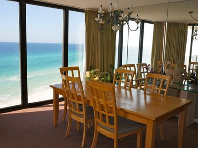 Dining area with floor to ceiling windows overlooking the gulf