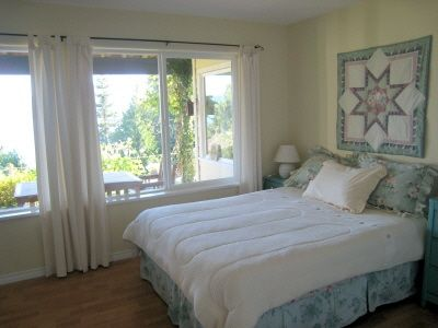 bedroom 2--queen-sized bed. All bedrooms are large and bright with ocean views.
