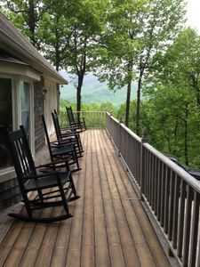 Deck along side of house with view.