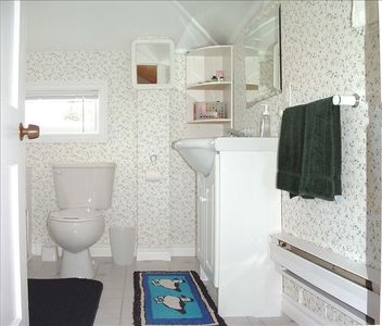 Upstairs bathroom with full bath and shower.