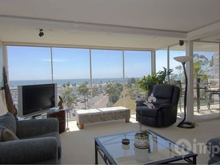 Oceanside condo photo - Living Room & Patio Views