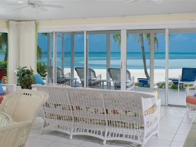 Two Rainbows Oceanfront living room and screened porch. PERFECT BEACH!!