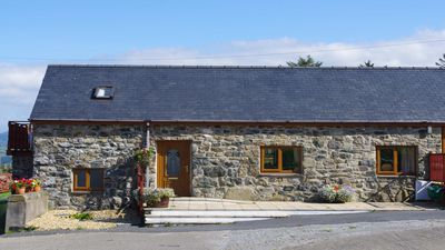 A barn conversion comprising two semi-detached cottages. - Cottage ISAF