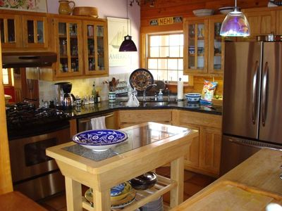 The gourmet kitchen, with granite countertops, baking island, recent appliances.