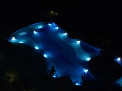 Villa Magna Infinity Pool at Night with Dramatic Lighting & Nearby Fireworks