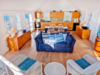 Vineyard Haven cottage photo - The Cottage Features An Open Loft-Style Layout With Vaulted Ceiling, French Doors & Ocean Views From Every Angle