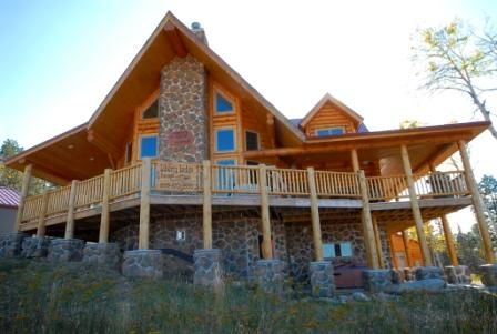 custom log cabin on ski in and ski out at vrbo