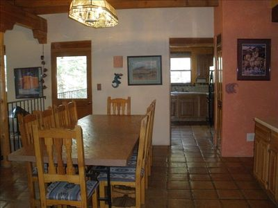 Large dining room with spacious kitchen with two sinks. Radiant floor heating.