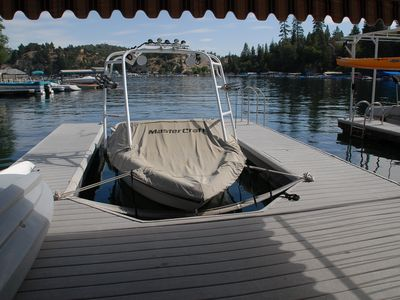 Dock view with kayak and canopy